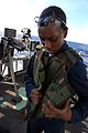 US Navy 081111-N-3610L-140 Aviation Ordnanceman 3rd Class Brittany Cooper puts on a bullet-proof vest.jpg