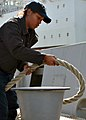 US Navy 090105-N-6764G-028 Seaman Lashaunda Briggs wraps mooring line around a bit.jpg