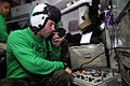US Navy 090505-N-2475A-002 Aircrew Survival Equipmentman 2nd Class Jason Bruce, from San Diego, Calif., checks the internal communication systems on an HGU-84-P helmet for the Eightballers of Helicopter Sea Combat Squadron (HSC.jpg