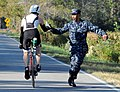 US Navy 091107-N-9936B-031 Damage Controlman 3rd Class John Pate, assigned to Operational Support Unit Wilmington, hands a water bottle to a competitor in the annual Beach2Battleship Triathlon.jpg