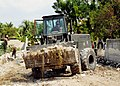 US Navy 100216-N-9643W-068 A Seabee assigned to Amphibious Construction Battalion (ACB) 2 removes rubble near Toussaint Louverture International Airport in Port-au-Prince, Haiti.jpg