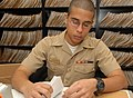 US Navy 100312-N-0486G-002 Personnel Specialist Seaman Apprentice Bernardo Tavarez sorts through a field service record at Personnel Support Detachment Mayport.jpg