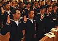 US Navy 100423-N-2218S-001 Service members take the Oath of Allegiance during a naturalization ceremony at the Chapel of Hope at Commander, Fleet Activities Yokosuka.jpg