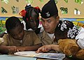 US Navy 100512-N-4971L-368 A Sailor plays with children during a Project Handclasp donation.jpg