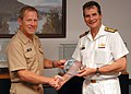 US Navy 100611-N-7032L-003 Rear Adm. Jonathan White, left, presents Commodore Rod Nairn with a memento.jpg