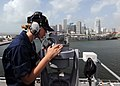US Navy 100721-N-3265K-066 Quartermaster Seaman Apprentice Katie A. Seavey uses a telescopic alidade to find navigation aides while pulling away from the port of Miami aboard the multi-purpose amphibious assault ship USS IWO JI.jpg