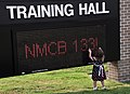 US Navy 100804-N-7367K-003 A child stands near the Training Hall marquee during a homecoming celebration for Naval Mobile Construction Battalion (NMCB) 133 at Naval Construction Battalion Center, Gulfport.jpg