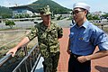 US Navy 100826-N-9818V-615 Master Chief Petty Officer of the Navy (MCPON) Rick West speaks with a Republic of Korea navy sailor during his visit to the Korean Turtle Ship.jpg