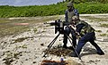 US Navy 100930-N-9402T-536 A Sailor engages in a live-fire training exercise at the British Indian Ocean Territory firing range. Sailors assigned t.jpg