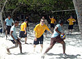 US Navy 101121-N-9061V-081 Sailors assigned to the guided-missile destroyer USS Momsen (DDG 92) join Maldivian coast guardsmen for a game of volley.jpg