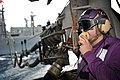 US Navy 110421-N-0569K-008 Aviation Boatswain's Mate (Fuels) Airman Michael A. Genera uses a sound-powered telephone to communicate with the fuels.jpg