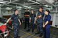 US Navy 110705-N-NB544-031 Aviation Ordnanceman 2nd Class Daniel Cooper, left, explains the different types of ordnance to midshipmen aboard aircra.jpg