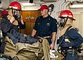 US Navy 120127-N-OH194-006 Damage Control Training Team member Senior Chief Logistics Specialist Mark Williams observes as Damage Controlman 3rd Cl.jpg
