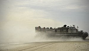 US Navy 120206-N-KB666-244 A landing craft air cushioned (LCAC) from the amphibious assault ship USS Kearsarge (LHD 3) comes ashore during an amphi.jpg