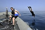 US Navy 130311-N-XQ375-210 Cryptologic Technician (Technical) 2nd Class Benjamin Peckinpaugh jumps into the water.jpg