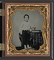 Unidentified boy holding cased photograph of soldier in Confederate uniform atop a Bible LOC 7029380811.jpg