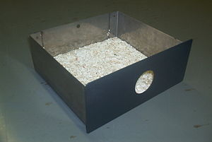 "Bit bucket - The chip receiver (or ""bit bucket"") from a UNIVAC key punch"