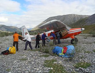 Wright Air Service - Wright Air Helio Courier unloading a rafting party.