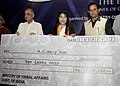 V. Kishore Chandra Deo presenting a Cheque of Rs. 10 lac to Smt. Mary Kom, the London Olympic Bronze Medal winner in Women's Flyweight Boxing, at a felicitation function.jpg