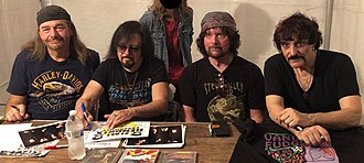 Vanilla Fudge - The current members of Vanilla Fudge with a fan. From left to right: Pete Bremy, Vince Martell, Mark Stein, Carmine Appice