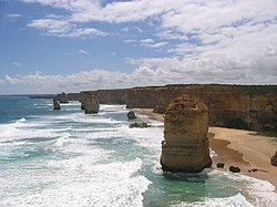 The Twelve Apostles, a collection of natural limestone stacks standing just off shore near Port Campbell.  Their proximity to one another has made the site a popular tourist attraction.