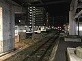 View of platform of Heisei Chikuho Railway from platform of Nogata Station (JR) at night.jpg
