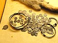 Viking age coin hoard from Sysma - 6 Islamic, 15 English, and 76 German coins, latest coin dates from 1006-1029 - National Museum of Finland - DSC04150.JPG