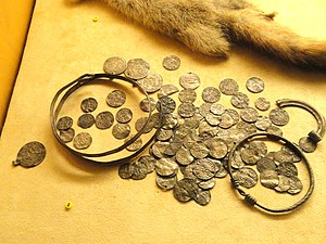 Islam in Finland - Image: Viking age coin hoard from Sysma 6 Islamic, 15 English, and 76 German coins, latest coin dates from 1006 1029 National Museum of Finland DSC04150