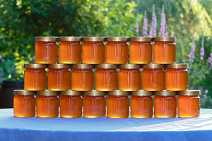 After harvest - jars of glass filled with honey
