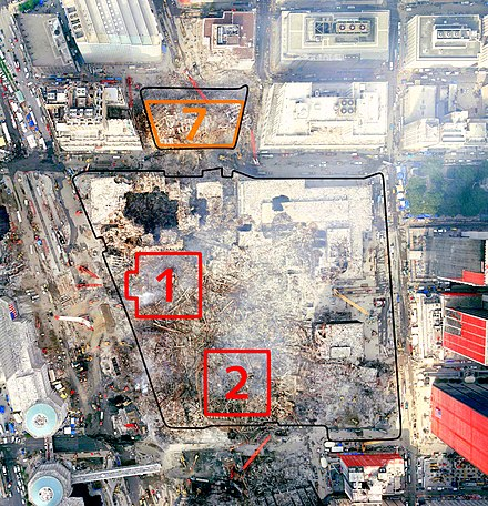 Aerial view of WTC remains and neighboring buildings after 9/11, with the original footprints of the Twin Towers and 7 WTC outlined WTC Area With Building Numbers 50dpi contrast.jpg