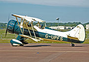 Waco UPF-7 (G-UPFS) arrives RIAT Fairford 10thJuly2014 arp