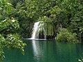 Water falls over the waterfall into the lake Okrugljak.jpg