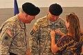 Wife pins on husband's brigadier general rank 141004-A-EB123-002.jpg