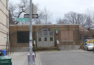 Wilson Avenue (BMT Canarsie Line) - Street entrance prior to wheelchair ramp implementation and staircase raised by one step.