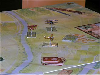 Miniature wargaming - Wings of War, which simulates World War 1 aerial combat.