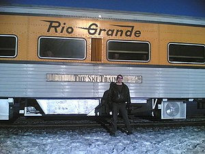 Ski Train - A man standing in front of the ski train on February 12, 2006