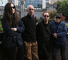 Wire in 2013; left to right: Matthew Simms, Robert Grey, Colin Newman, Graham Lewis