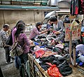 With temperatures in HK down to 20 degrees, the locals are rushing to buy wooly hats! (8228656112).jpg
