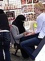 Woman with Niqab doing Henna in Portland, Oregon (4411723743).jpg