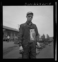 Worker with a personal monogram on his overalls 8d29155v.jpg