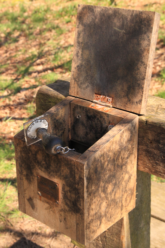 """Letterboxing (hobby) - A letterbox by Alec Finlay, with a rubber stamp poem: """"There is a fork in every path""""."""