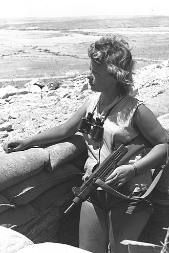 Uzi -  An Uzi-armed Israeli on guard duty in the Negev (1956). Note wooden stock.
