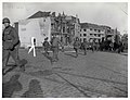 111-SC-271269 - Troops of the 35th Infantry Division, Ninth U.S. Army move through the streets of Venlo, Holland, as their drive moves into Germany.jpg