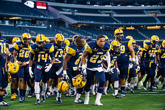 Texas A&M–Commerce Lions football - The 2014 team before playing the Texas A&M–Kingsville Javelinas at AT&T Stadium
