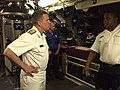 150508-N-ZZ999-001 Rear Adm. Tom Reck, left, speaks with Cmdr. Thamsanqa Matsane.jpg