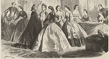 Bodices ended at the natural waistline. Wide pagoda sleeves are in fashion, and skirts are longer at the back; depicting a train.