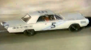 White Chrysler Turbine Car with a number on its side