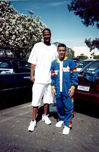 Billy Owens - Owens (left) pictured with a fan in 2002