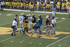 Brandon Graham - Graham during coin toss with Tim Hiller and teammates Carlos Brown, Zoltan Mesko and Mark Ortmann.