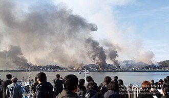 Bombardment of Yeonpyeong - Yeonpyeong Island under North Korean artillery attack